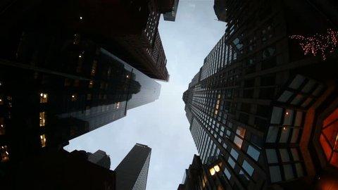 NYC midtown Manhattan looking up skyscrapers dark winter sky gloomy gothic