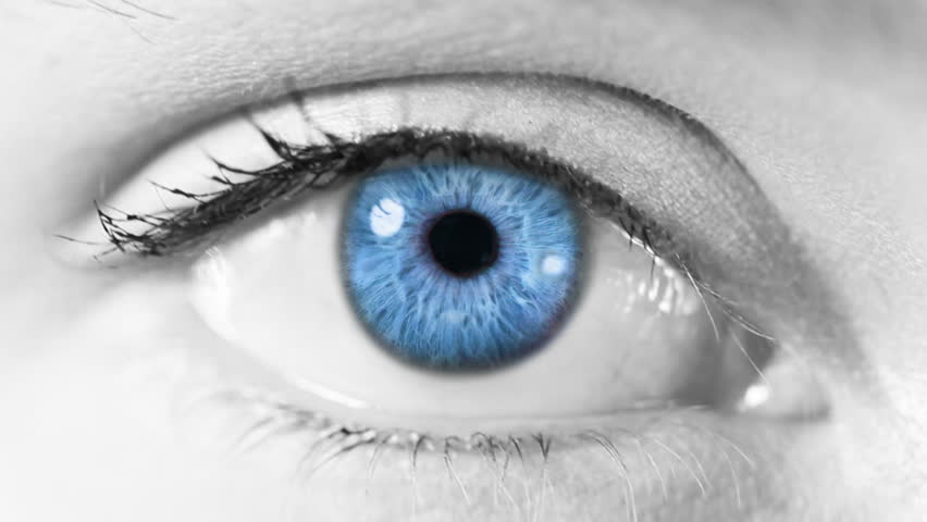 Computer Network. Eye. Blue. Gray skin. Zoom in from a blue human eye to a network animation. Technology background.