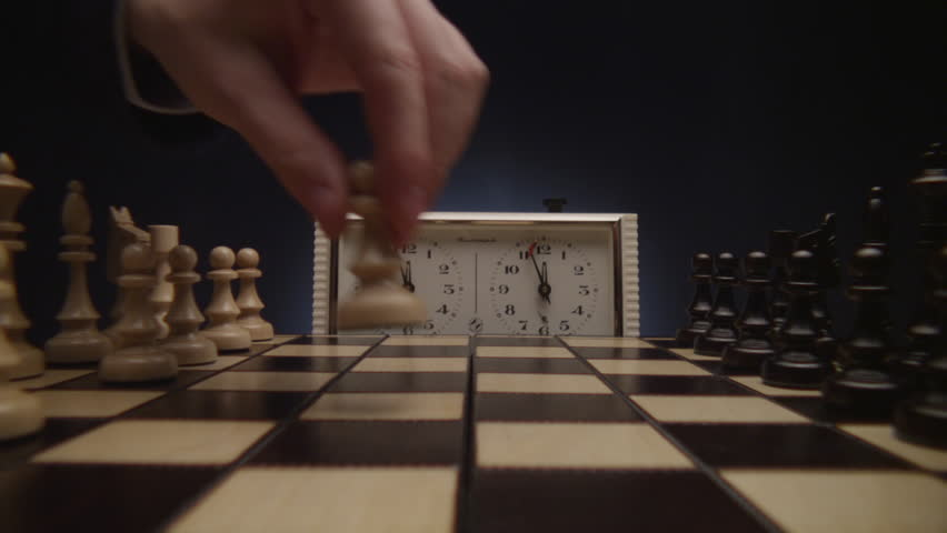Chess boards and chess pieces game clock - 4K stock footage clip