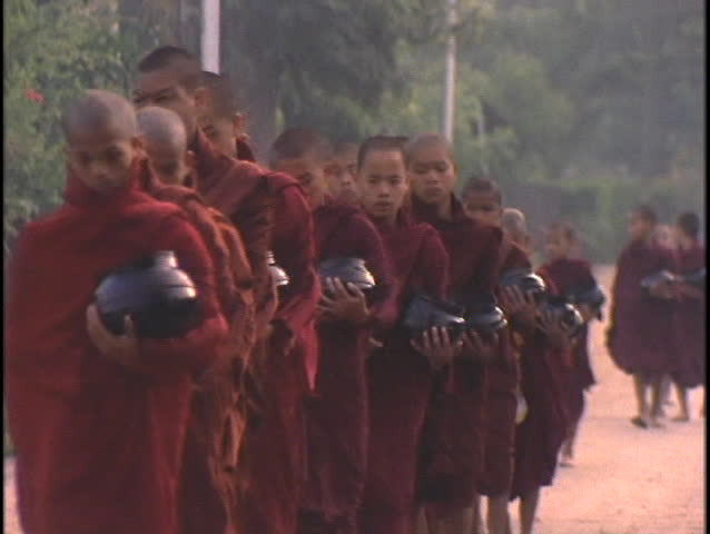 BURMA - CIRCA 2010: Buddhist monks collect alms in the morning circa 2010 in Burma.
