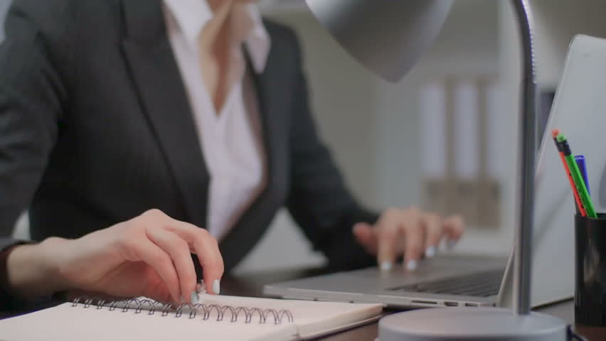 Close up of the female hands printing and writing something to notebooks. The girl attentively performs the work. In slow motion In slow motion  | Shutterstock HD Video #13890947