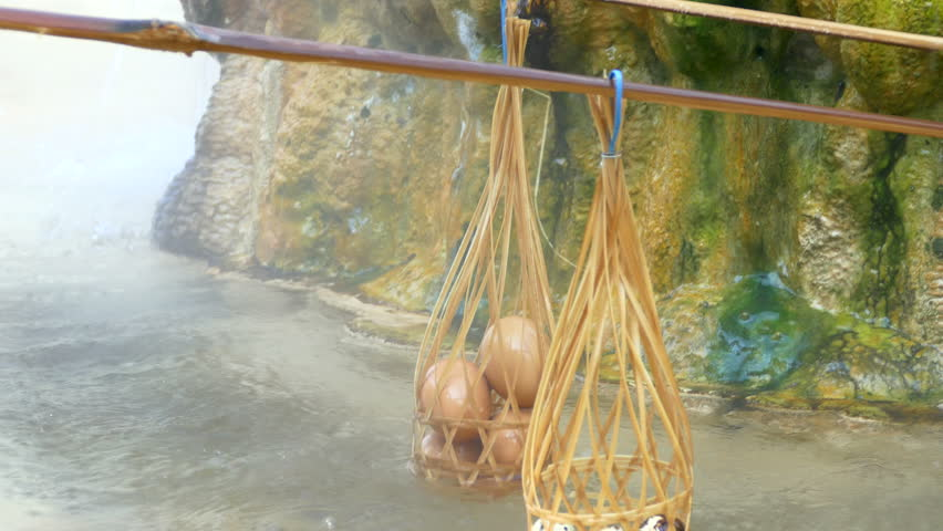 Traveler trial boiled eggs and quail eggs In the hot springs Mae Kasa. The hot springs is large for the tourists interested to visit at Tak, Thailand | Shutterstock HD Video #13901927