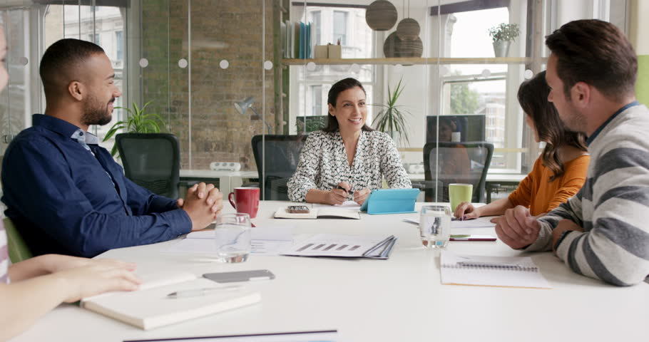 Diverse business people clapping in Creative team meeting celebrating success in casual modern office boardroom with natural light and large open windows   Shutterstock HD Video #13949987