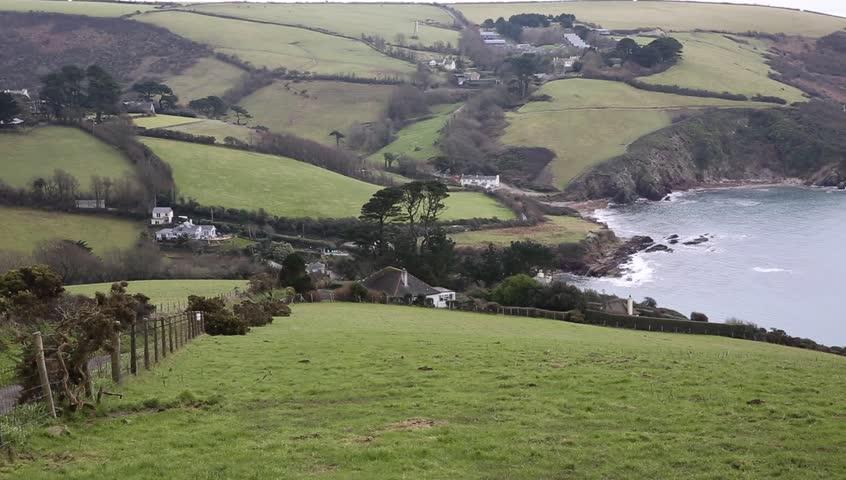Talland Bay coast Cornwall between Looe and Polperro England UK pan of coastline