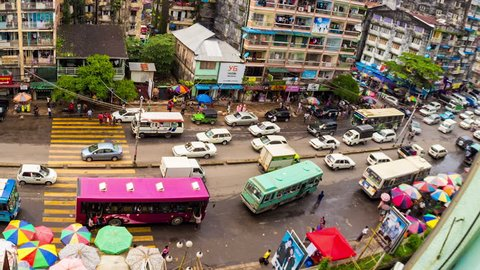 YANGON - AUG 27, 2013: Timelapse view of a busy city street market in central Yangon showing people going about their daily lives in the economic center of the country on 27 August 2013 in Yangon, Myanmar