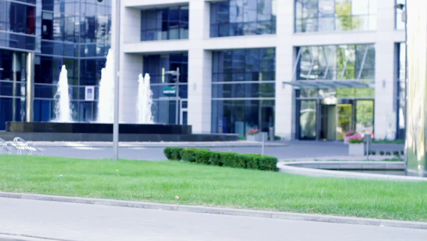 building an office. A Beautiful Young Caucasian Business Woman Walking Outside Office Building Stock Footage Video 1402717 | Shutterstock An