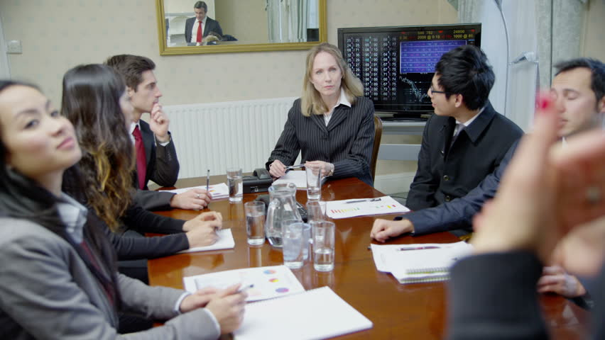 4k / Ultra HD version Happy and enthusiastic team are seated around a table for a meeting, in an elegant, classically styled conference room. In slow motion. Shot on RED Epic | Shutterstock HD Video #14048627
