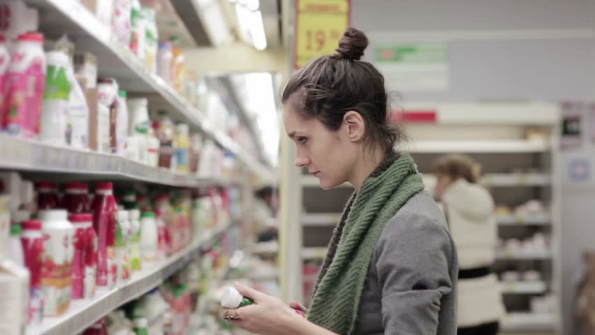 Young woman chooses dairy produce in the store | Shutterstock HD Video #14050583