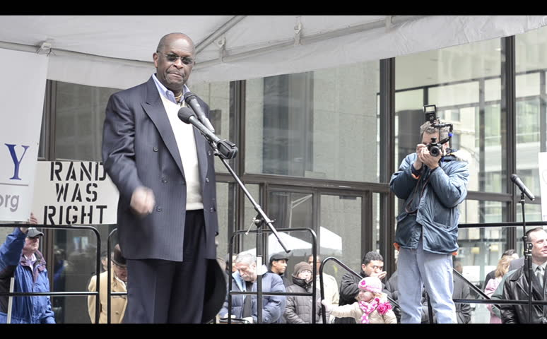 CHICAGO, IL - APRIL 18: Presidential Candidate Herman Cain speaking about inspiration at the tea party rally in Chicago's Daley Plaza April 18, 2011, Chicago Illinois.
