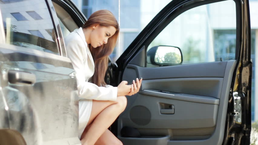 Attractive business woman using mobile phone