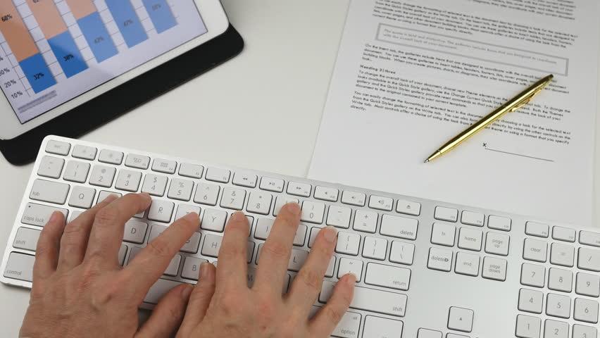 Womans hands Typing on Keyboard in Office    Shutterstock HD Video #14110097