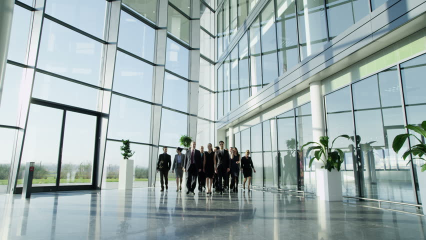 4k / Ultra HD version Portrait of an attractive multi-racial business team, as they walk through a light and modern glass fronted office building towards the camera. In slow motion. Shot on RED Epic | Shutterstock HD Video #14126681