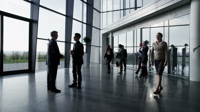 4k / Ultra HD version An attractive businessman and businesswoman who are old acquaintances, meet and shake hands in the lobby of a bright modern office building. Shot on RED Epic   Shutterstock HD Video #14126927