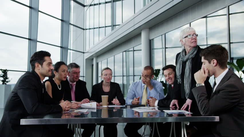 4k / Ultra HD version A confident and happy business team are holding a meeting in a light, modern office building. They are discussing ideas for their business development. Shot on RED Epic | Shutterstock HD Video #14127647