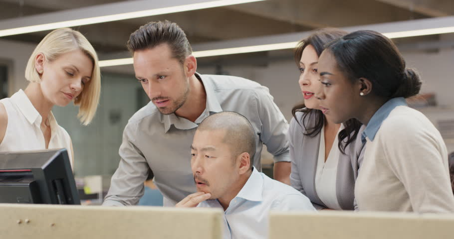 Creative business team meeting in modern glass office multi ethnic group of people working over computer screen on combined teamwork project | Shutterstock HD Video #14141795