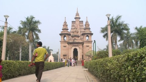 India - CIRCA 2013 - People walking up the path to the Mulagandhakuti shrine at Sarnath.