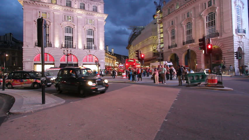 LONDON, UK - JULY 25: Traffic and pedestrians on Piccadilly Circus in the evening on July 25, 2011 in London, UK. Piccadilly Circus is a road junction and public space of London's West End in the City of Westminster, built in 1819 to connect Regent Stree