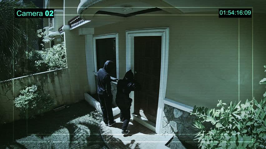 CCTV watching how Burglars breaking into a house via a door with a lockpick.