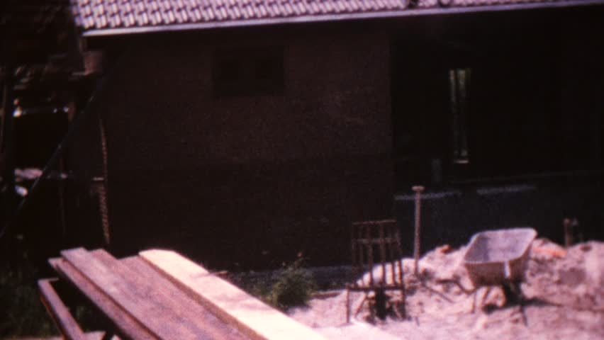 CIRCA 1968: Vintage 8mm film of constructing a house