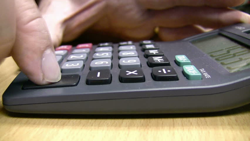 Close up side view of a desktop calculator in use. Cinemagraph  - a still image with small section of looping video giving a living feel to the picture. | Shutterstock HD Video #14377525