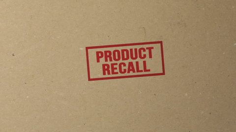 Shot of Marking for Product Recall With Red Ink Stamp