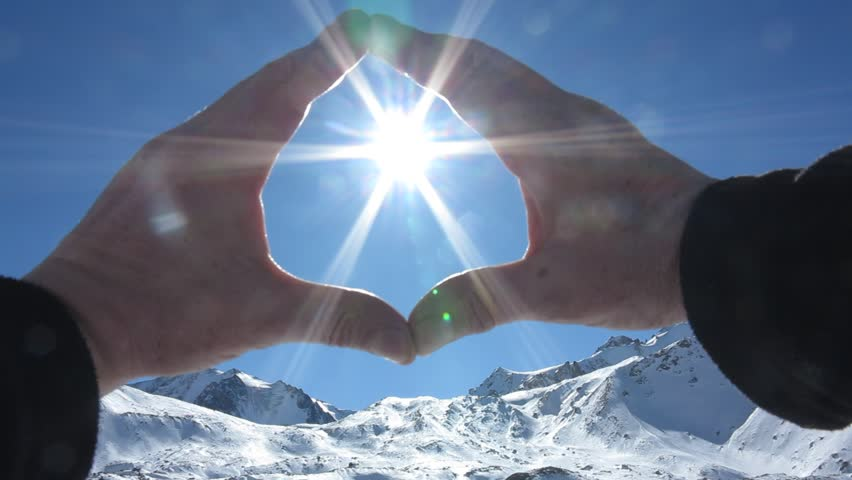 The bright mountain Sun does not fit in the Palms  | Shutterstock HD Video #14431087