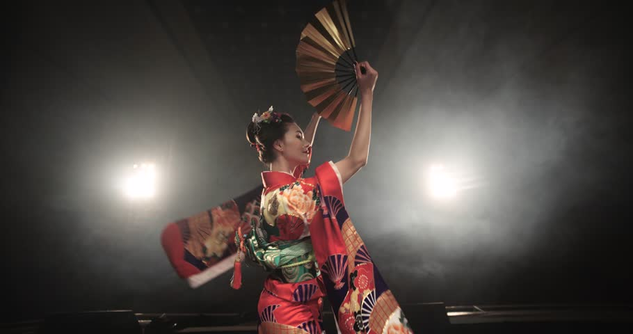 4K beautiful Japanese geisha dancing on stage and posing for the camera,the smoke in the background, slow motion #14442817