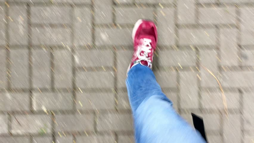 Feet walking on the street with RED shoes POV