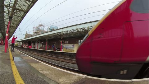 PENRITH, ENGLAND - JANUARY 23: A Virgin Pendolino train is seen arriving in Penrith Station, Cumbria on January 23, 2016, on the English west coast mainline (2.7k, 25fps).
