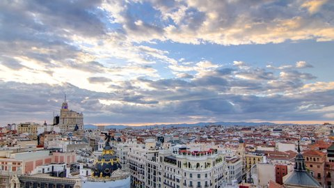 Panoramic aerial view of Gran Via timelapse at sunset, Skyline Old Town Cityscape, Metropolis Building, capital of Spain, Europe.