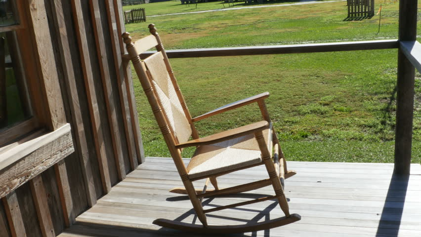 Wooden Rocking Chair On Front Porch   4K Stock Footage Clip