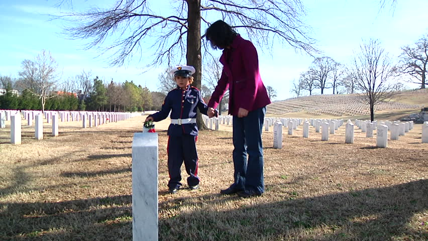 Family visiting grave of fallen solider