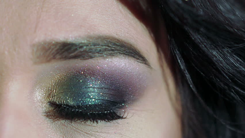 Close up of girl's big eye. Slowly   Shutterstock HD Video #14559454