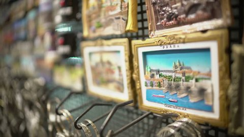PRAGUE, CZECH REPUBLIC - CIRCA DECEMBER 2015: Street shopping. Zoom-in on Prague Czech Republic souvenir fridge magnet displayed at gift shop