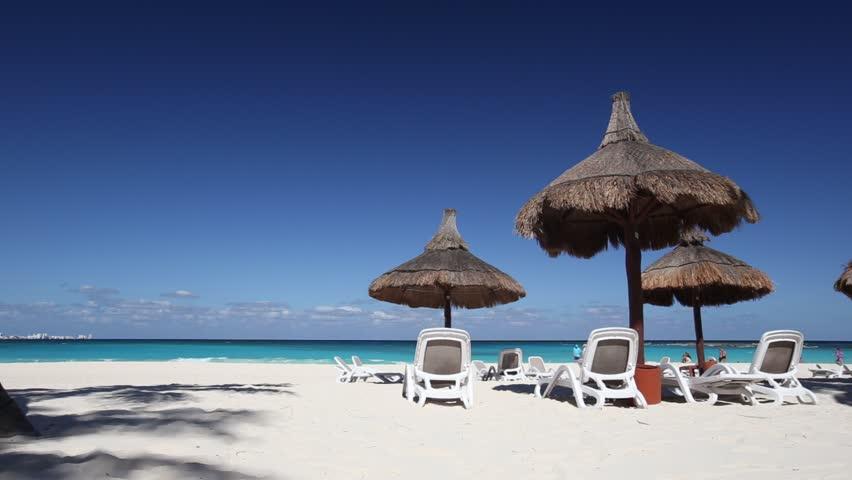 Beach Chairs And Gr Umbrellas On A Stunning Tourist Resort