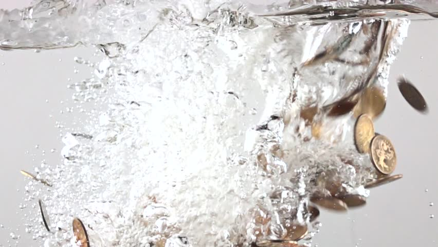 Super slow motion video of multiple coins sinking in water. Crisis concept #14607727