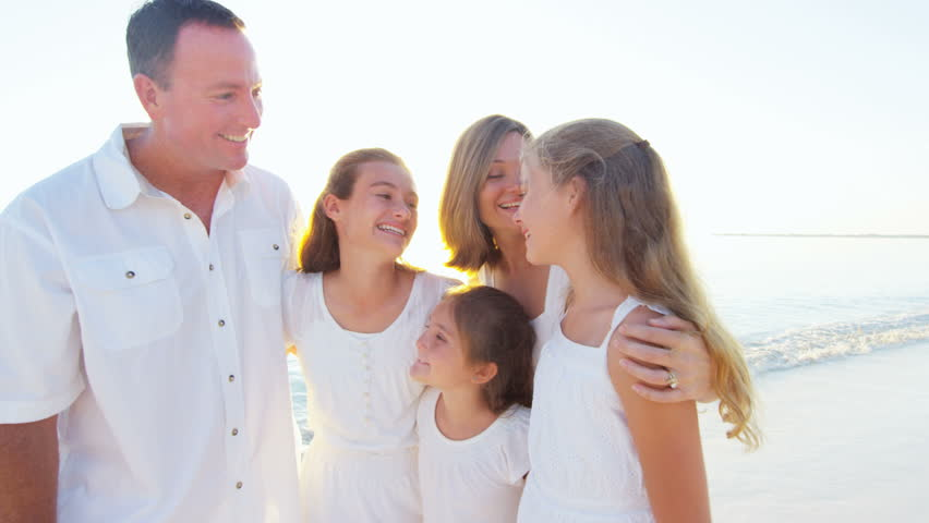 Portrait of a smiling Caucasian family wearing white clothes on beach   Shutterstock HD Video #14609167