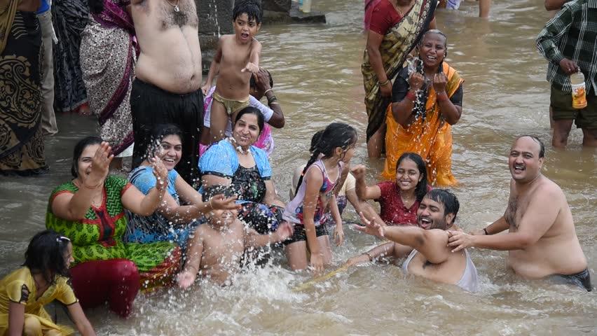 cb0e63bf0d9 NASHIK, MAHARASTRA, INDIA - SEPTEMBER 19 : devotee take a holy bath at the  Ramghat on the Godavari River during the Simhastha Kumbh Mela, September  19, ...
