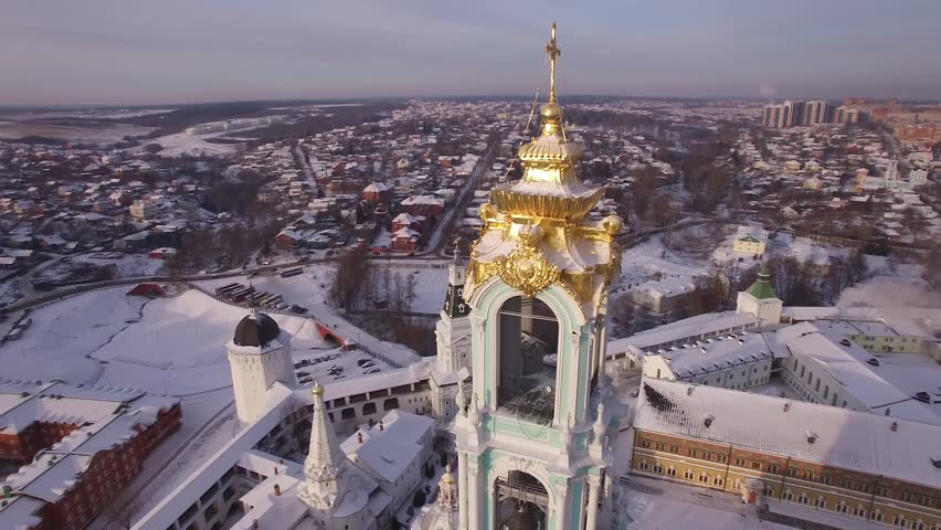 Aerial views Beautiful winter Russia. Flying over the Trinity Lavra of St. Sergius. Frozen old monastery and church covered with snow. Village. Religious. Unique footage from quadcopter drone. | Shutterstock HD Video #14679637