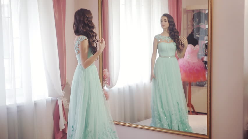Happy woman looking in the mirror, admiring the chosen dress and spinning it | Shutterstock HD Video #14732077