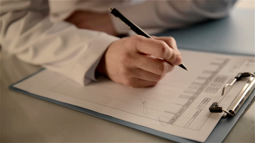 Close-up of woman physician hands holding ballpoint, studying patient's treatment scheme. Female doctor doing paperwork in the office.
