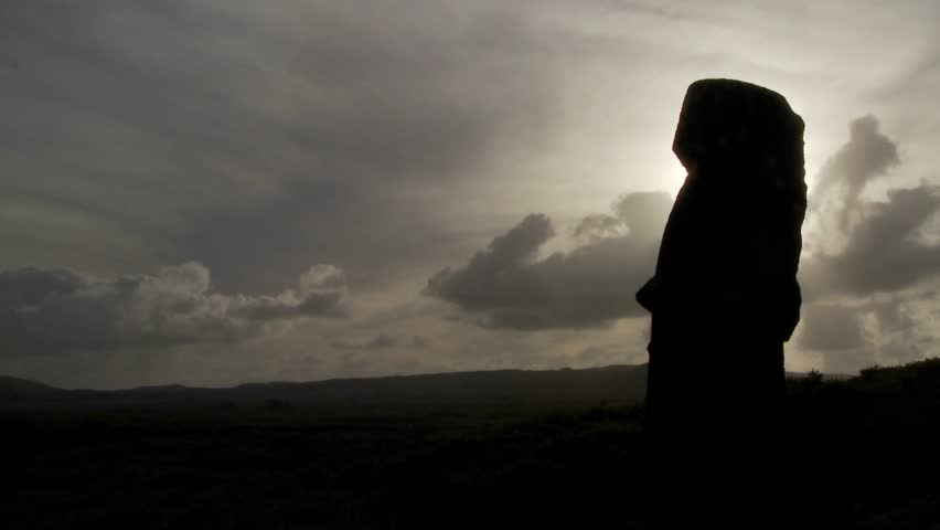 Time lapse of amazing clouds with Easter Island statues in silhouette.