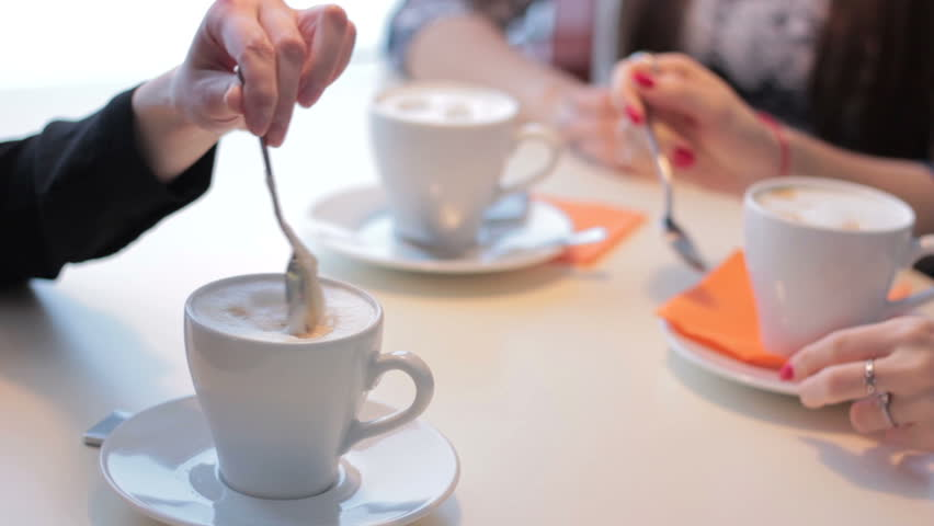 Female hands with cup of coffee in a coffee shop | Shutterstock HD Video #14787451