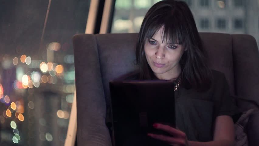Young asian woman using tablet pc computer reading ebook on subway pretty woman using tablet computer sitting on chair at home at night hd stock footage fandeluxe Ebook collections