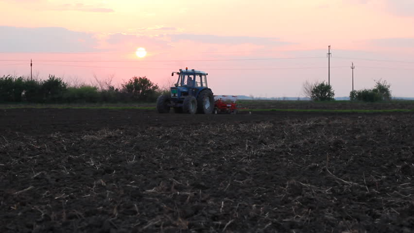 Seeder for sowing in a field at sunset