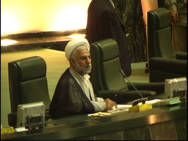 Parliament, Tehran, Iran - 2005 - Clip shows a Muslim cleric and MP listening to the Chairman Gholam Ali Haddad Adel's speech.