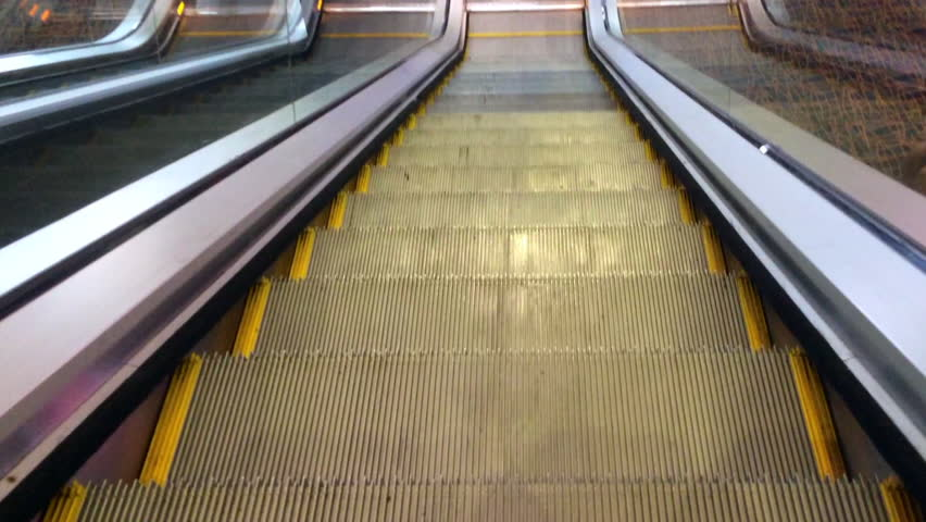 Travel Down On Escalator Moving Staircase   HD Stock Footage Clip