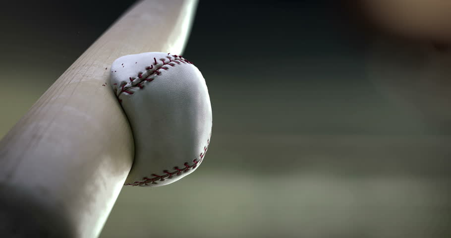 Super hit. Baseball bat hits the ball in slow motion, close-up, you can see how deformation ball and breaking seam thread