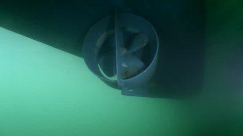 Propeller ship underwater.