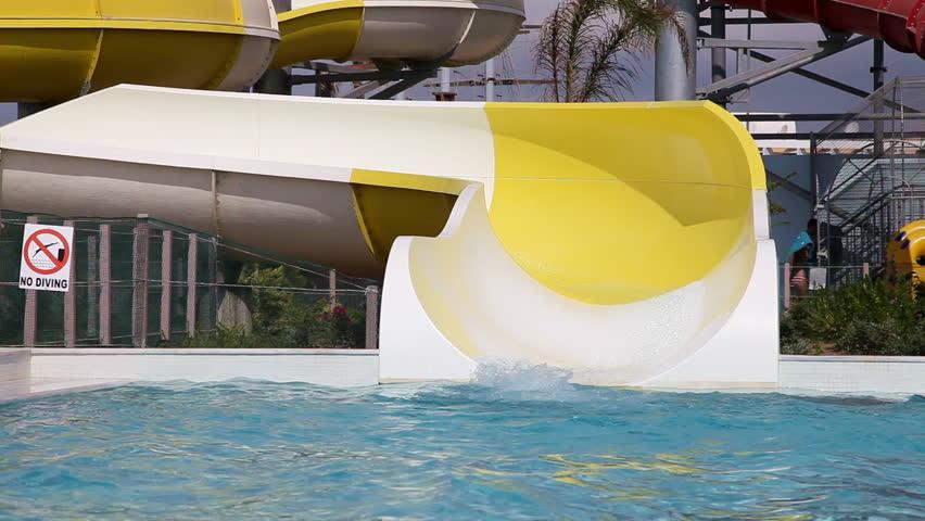 Senior couple Having Fun On Water Slide